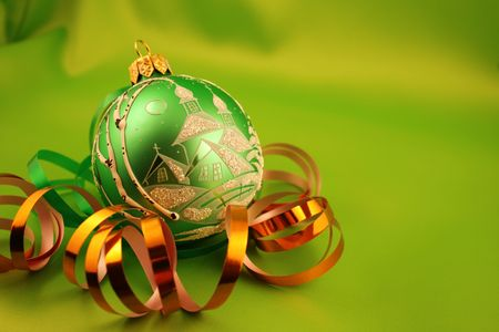 Christmas bauble on a green background Stock Photo - 666256