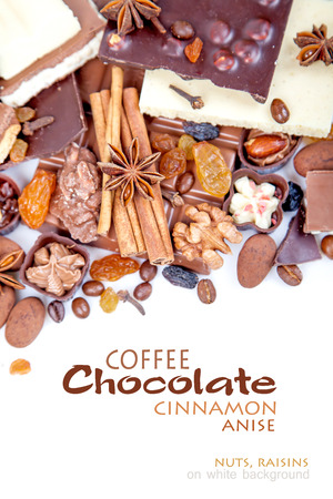 anise: Various pieces of chocolate with nuts, raisins and coffee beans on a white background Stock Photo