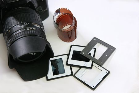 35: Camera, 35 mm film and slides on white background