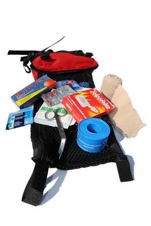 painkillers: First Aid Kit with content: bandage, bandaid, painkillers, gauze and scissors Stock Photo