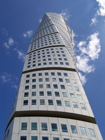 an upward view of the turning torso twisted tower block in malmo Stock Photo