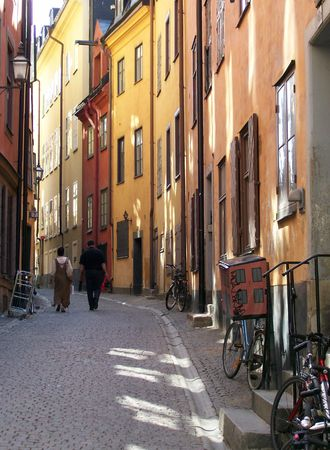 an ancient old street in the gamla stan area of stockholm shaded on a very hot summer day photo