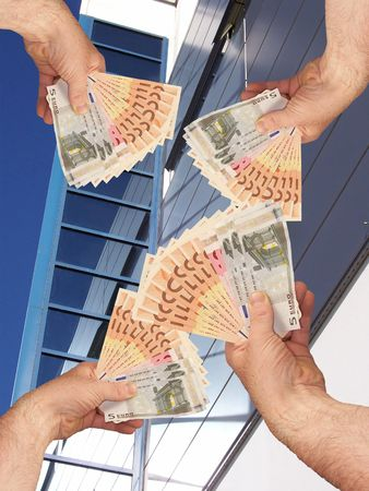 An image of hands holding out a wads of cash in front of a corperate office building facility Stock Photo - 1092042