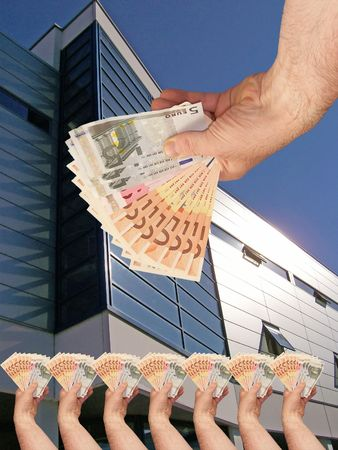 An image of hands holding out a wads of cash in front of a corperate office building facility Stock Photo - 1092047