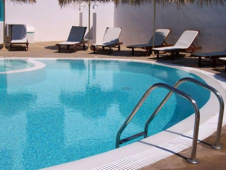 beautiful swimming pool by the beach in kamari Stock Photo - 1105505