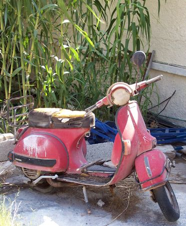 a wrecked abandoned old moped scooter left to rot Stock Photo - 1118804