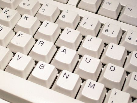 pirated: Keys rearranged on a computer keyboard to spell out the word fraud Stock Photo