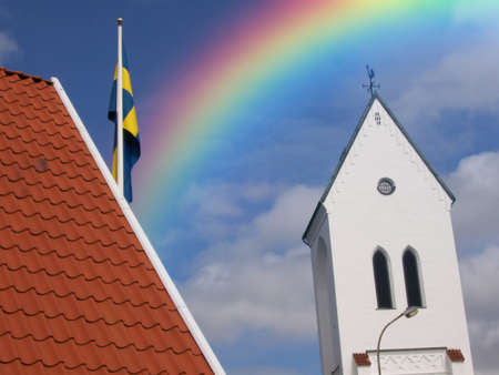 colourful rainbow over a church in torekov in sweden Stock Photo - 1525035
