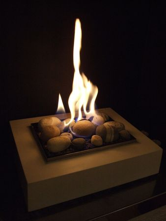 gas fireplace: warm gas fire in a homly fireplace Stock Photo