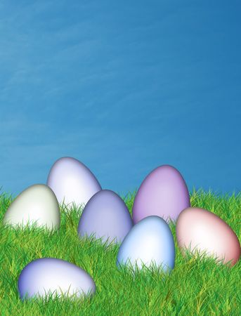 easter eggs in lush green grass and warm blue sky Stock Photo