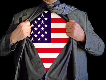 A business man isolated against a black background tearing open his shirt to reveal an american flag on a t shirt Stock Photo - 2556482
