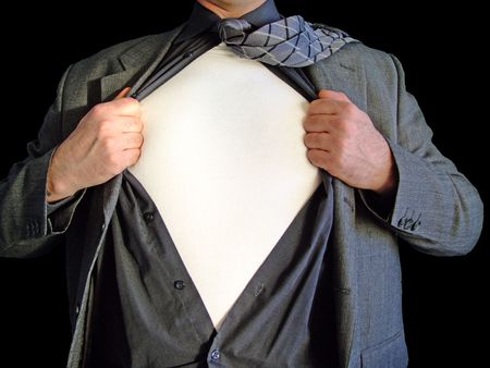 A business man tearing open his shirt to reveal a blank t shirt for your companys logo isolated against a black background Stock Photo - 2556480