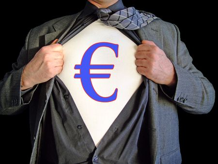 A business man isolated against a black background tearing open his shirt to reveal a  euro dollar sign on a t shirt Stock Photo - 2556489