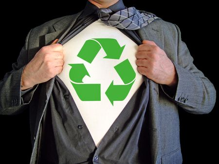 A business man isolated against a black background tearing open his shirt to reveal a recycle sign on a t shirt photo