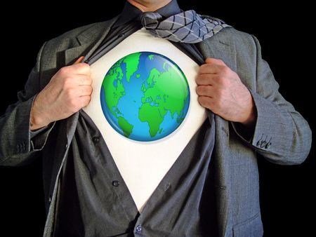 A business man isolated against a black background tearing open his shirt to reveal a  world map on a t shirt Stock Photo - 2556490