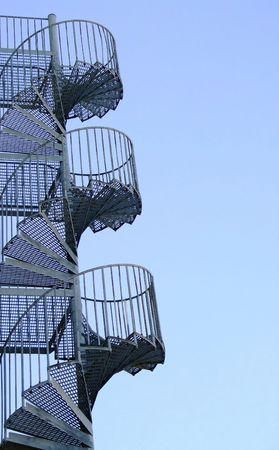 a metal spiral fire escape on the side of a block of flats Stock Photo - 2989127