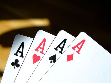 card player: four aces in the hand of a very lucky card player