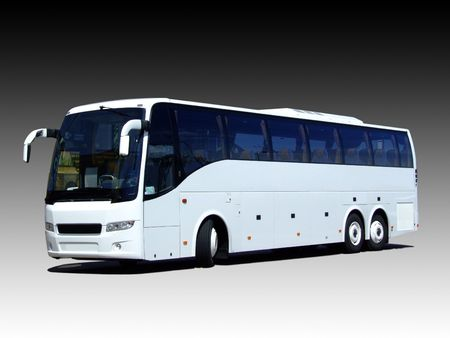 A white tour bus isolated on a black and white gradient