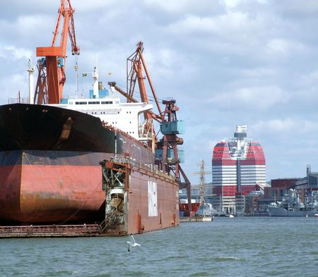 giant industrial tanker undergoing repairs at drydock in gothenburg Stock Photo