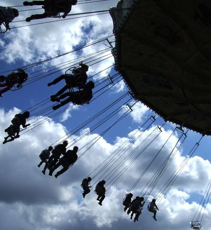 a fairground ride silhouetted against a blue summer evening sky photo