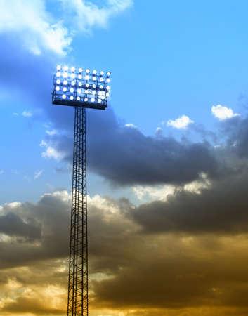 a football stadium floodlights set against a summer sunset sky photo