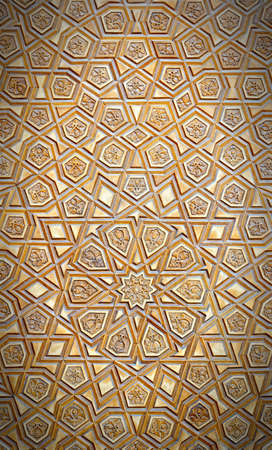 wood carvings: An artistic carved pattern in wood of an islamic arabic nature. Stock Photo