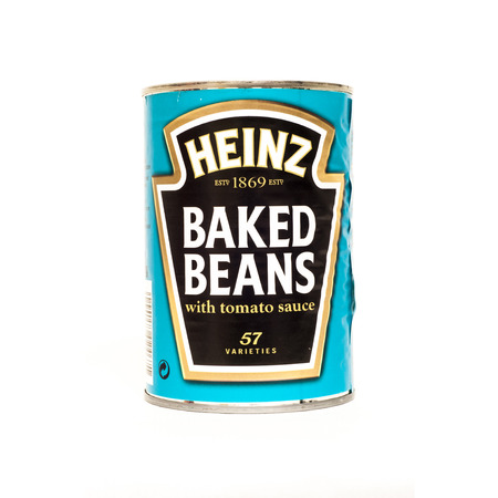baked beans: HELSINGBORG, SWEDEN - DECEMBER 29, 2013  Heinz Baked Beans in a tin can  The H  J  Heinz Company manufactures thousands of food products in plants on six continents, and markets these products in more than 200 countries and territories