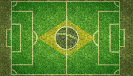 footie: An overhead view of a football soccer pitch with white markings and the flag of Brazil painted on grass. Stock Photo