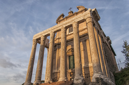 The ancient ruin of the Roman Temple of Antoninus and Faustina situated in the Italien capital of Rome. Stock Photo - 25082193