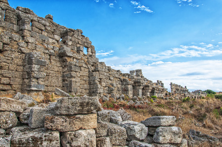 Part of the ancient city wall ruins that surround the town of Side in Turkey. Stock Photo - 25082190