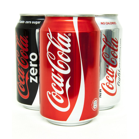 trademark: HELSINGBORG, SWEDEN - January 21, 2014: 0,33l Various Coca-Cola cans Isolated On White Background. Coca-Cola is a carbonated soft drink sold in shops, restaurants, and vending machines around the globe.