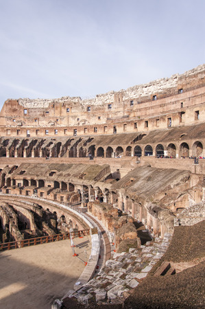 A view of the impressive ancient roman colosseum situated in the Italien capital of Rome. photo