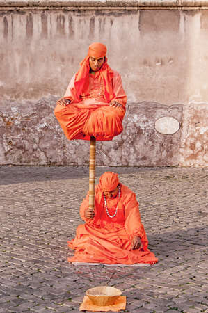 levitation: ROME, ITALY - JANUARY 08: Indian Fakirs performing levitation trick in Rome on January 08, 2014. In 2011 city council proposed to regulate street performers to remove many of them from Rome.