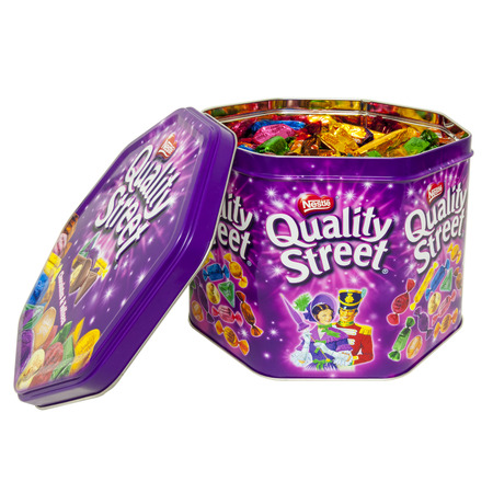 nestle: HELSINGBORG, SWEDEN - December 20, 2014: Quality Street Chocolate selection Isolated On White Background. Quality Street is a popular selection of individual sweets, usually contained in tins or boxes, manufactured by Nestle in England.