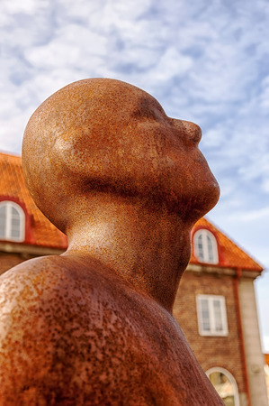 naked statue: A bronze statue of a naked male figure in the Swedish town of Hoganas.