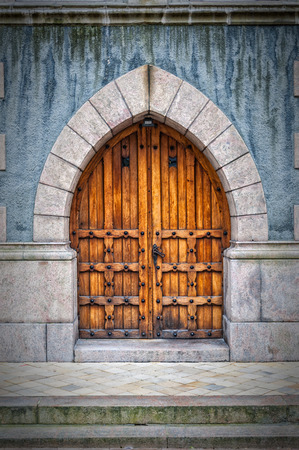 arched: Wooden arched doors from the town hall building in Helsingborg, Sweden.