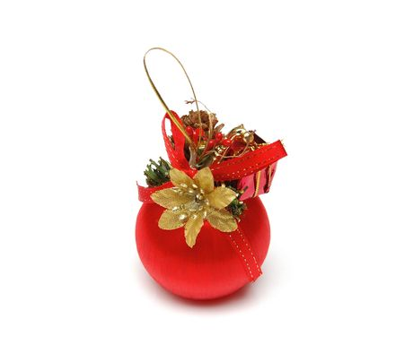 unique christmas ball of red color with a goldish flower and ribbon by a bow photo