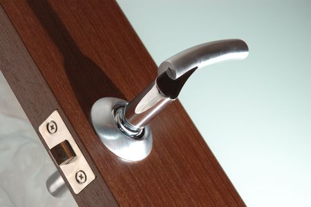 Open modern wooden glass door winh handle. Diagonal photo with direct hard light. Stock Photo