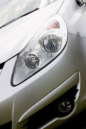 Hood of modern car after rain with drops on a headlight. Stock Photo - 1179661