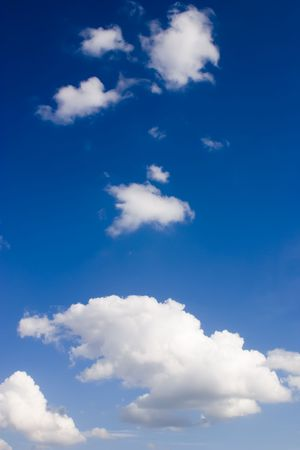 Deep blue sky & clouds in the summer day. Vertical shot. Stock Photo - 1179837