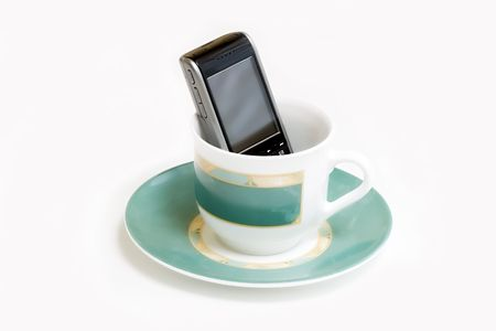 coffeecup: Coffee-cup and in it smartphone