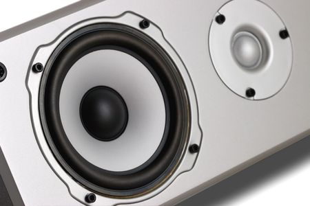 Home Theater 2-Way Speaker System, close-up photo.Focus on low side of woofer. photo