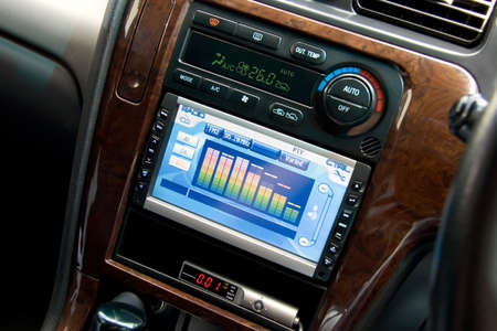Modern luxury car interior, tvdvdaudio system with monitor and climat control view.