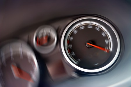 Dashboard (speedometer and tachometer close-up)  with motion gauges. Speed Concept. Stock Photo - 1464016