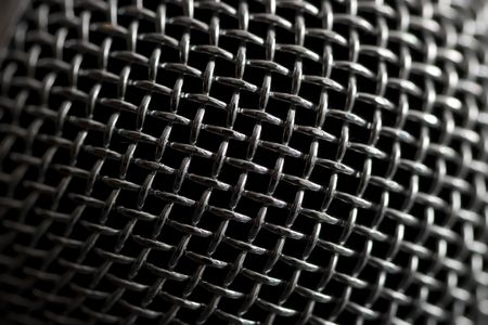 Steel grille background. Close-up shot of microphone. Stock Photo - 1842132