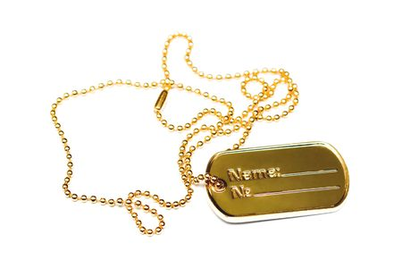 Golden dogtag. Photo isolated on white background.