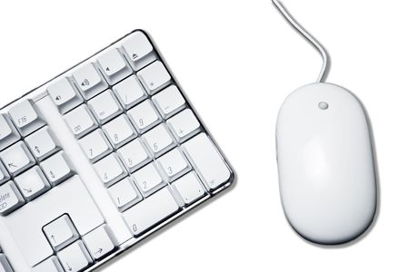 Conceptual picture with white mouse and part of computer keyboard. Stock Photo