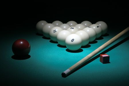 snooker cues: Billiard. Balls pyramid fith number 8 ball on a foreground.