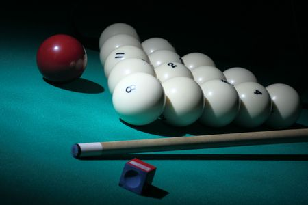 snooker cues: Pool. Balls pyramid with number 8 ball on a foreground.