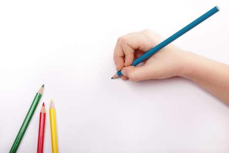Child hand draws a blue pencil.